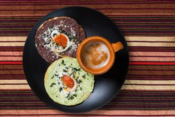 typical toast with black beans and guacamole from Guatemala
