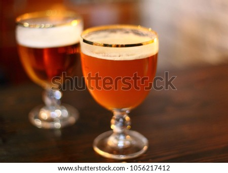 Typical traditional belgium draft beer, cold beer with foam #1056217412