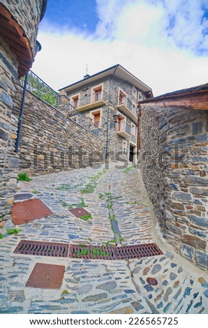Typical traditional dark brick Andorra rural mountain houses in the village of Llorts near Andorra la Vella in the Pyrenees
