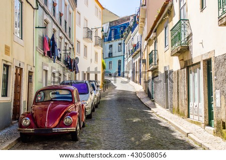 Typical traditional portuguese street with old classic vintage beetle car in Lisbon, Portugal