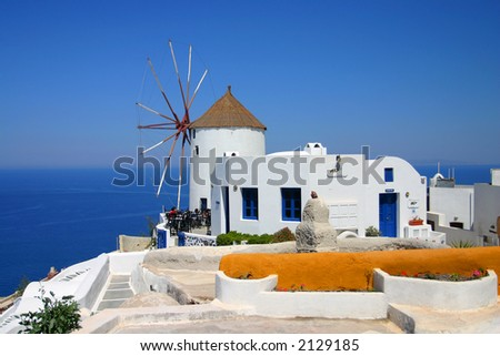 Typical traditional windmill in terraced village Fira, on Santorini island, from Cyclades archipelago, Greece