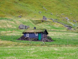 Typical turf-top house on the f Kalsoy Island. Faroe Islands, Denmark, North Europe