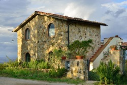 Typical Tuscan old farmhouse. View on the fasade at sunrise