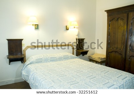 Typical Two Star Hotel Room In Paris France With Armoire