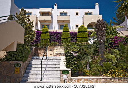 typical vacation hotel apartments with beautifully maintained garden areas on the greek island of rhodes