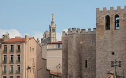 Typical view of Marseille and the historic churches Notre Dame de la Garde and Saint Victor in South France