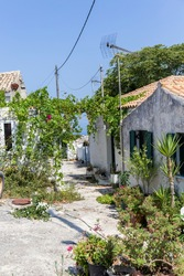 typical village with white houses and many plants in the interior of the island of Zakynthos in Greece