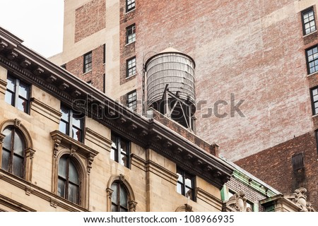 typical water tank on top of a building in new york #108966935