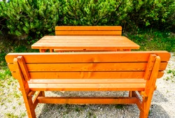 typical wooden parkbench at a forest