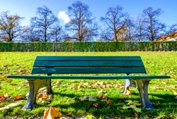 typical wooden parkbench at a patio