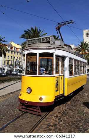 Typical yellow Tram in Lisbon street, Portugal