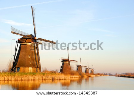 Typically dutch scenic with windmills at sunset. - stock photo