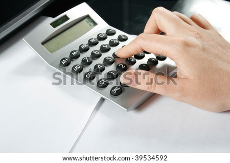 Typing numbers for income tax return with calculator