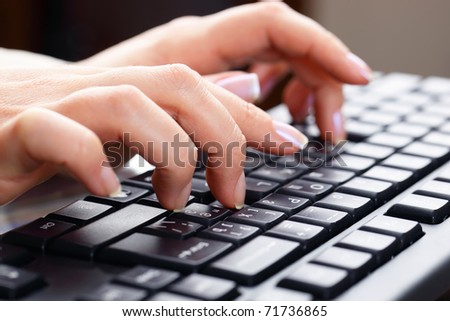 Typing on keyboard. - stock photo