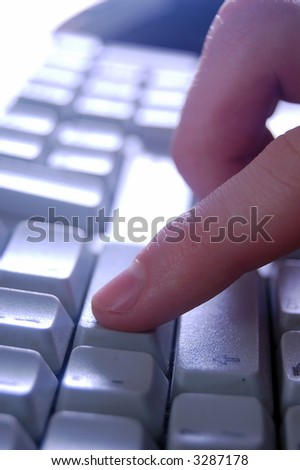 Typing on keyboard close up