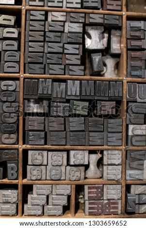 Typographic mobile characters collected in a drawer for typography. Collection of antique letterpress art pieces with movable type. elements of a typography to print letters