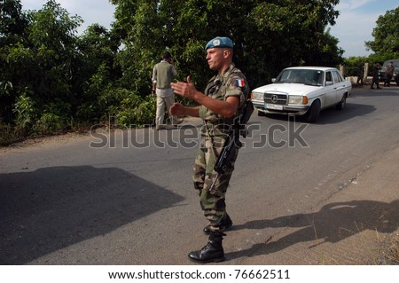 TYR, LEBANON-OCTOBER 18:Unidentified UN soldier on patrol on October 18, 2006 in Tyr, Lebanon - stock photo
