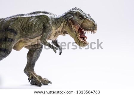 Tyrannosaurus rex with open jaws #1313584763