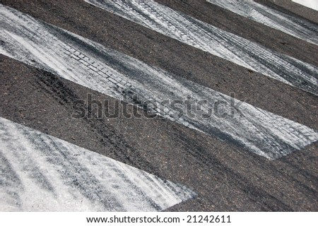 tyre marks on road - stock photo