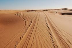 Tyre / Tire Tracks Through The Desert Sand Dunes