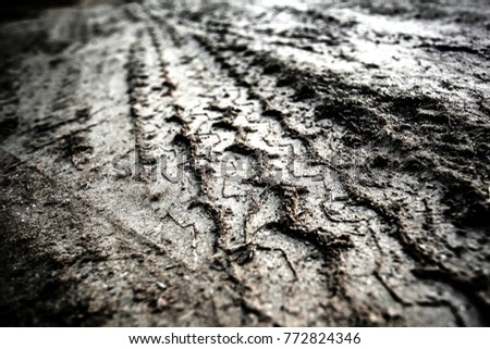 Tyre track on dirt sand or mud, retro tone, grunge tone, drive on sand, off road track #772824346