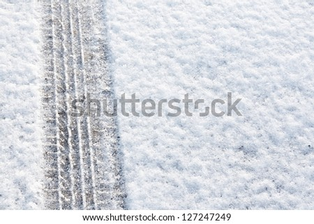 tyre tracks imprinted into fresh snow a great background for rallies or four wheel drive cars