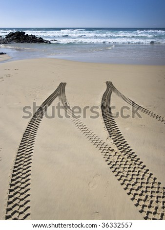 Tyre tracks on beach