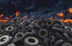 Tyres are on fire. Burning old tyres on recycling landfill. Black smoke from tires fire. Tyre graveyard at rubber burning plant. Wheel tire recyclers, tyre for reuse. Pile of old wheels in blaze.