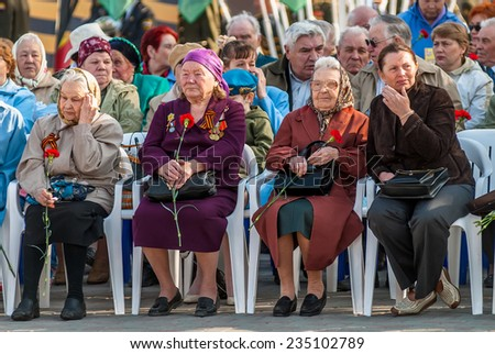 Tyumen, Russia - May 9. 2009: Victory Day in Tyumen. Senior female veterans of World War II meet on tribunes waiting for parade