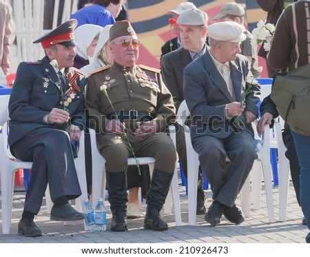 Tyumen, Russia - May 9. 2009: Victory Day in Tyumen. Veterans of World War II on tribune waiting for parade
