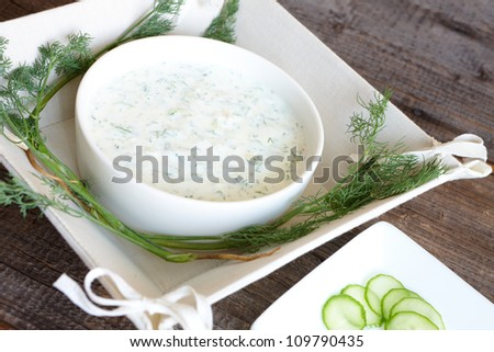 Tzatziki or tzadziki is a Greek and Turkish meze or appetizer, also used as a sauce for souvlaki and gyros. Made of strained yoghurt mixed with cucumbers, garlic and salt.