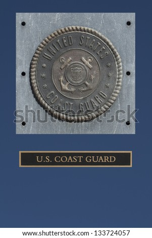 U.S. Coast Guard emblem on granite with blue background