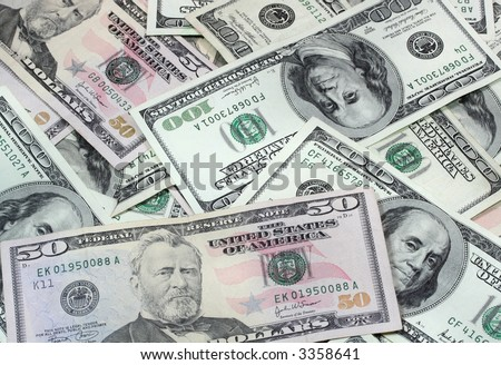 U.S. currency.  New 50 dollar and older style 100 dollar U.S. bills.