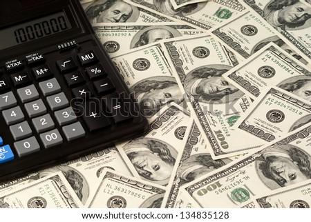U. S. Dollars and calculator. Studio shot.