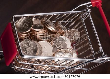 U.S. dollars in a stylized metal wheelbarrow service from the store.
