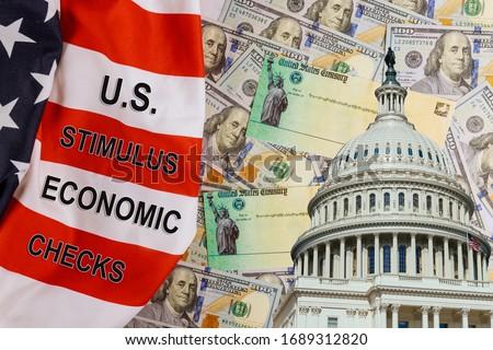 U.S. Economic STIMULUS CHECKS Bill Coronavirus Global pandemic Covid 19 financial lockdown from government US 100 dollar bills currency on American flag Photo stock ©