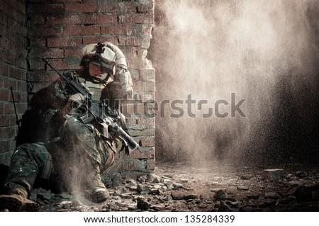 Stock Photo U.S. marine hiding from explosion