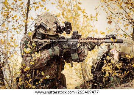 U.S. Rangers team aiming at a target of weapons
