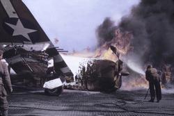 U.S. Republic P-47 Thunderbolt in flames after crash landing, Sainte-Mere-Eglise, France. June 1944, Normandy, World War 2. B&W Photo with oil color.