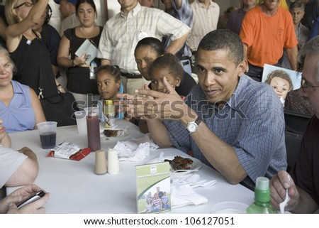 U.S. Senator Barak Obama campaigning for President while eating dinner at Iowa State Fair in Des Moines Iowa, August 16, 2007