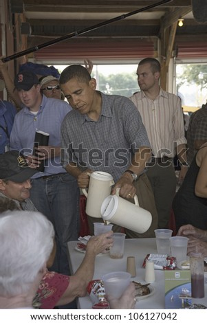 U.S. Senator Barak Obama campaigning for President while pouring lemonade at Iowa State Fair in Des Moines Iowa, August 16, 2007