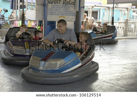 U.S. Senator Barak Obama driving bumper car with his daughter while campaigning for President at Iowa State Fair in Des Moines Iowa, August 16, 2007