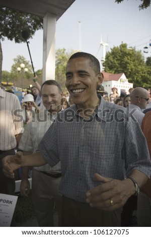 U.S. Senator Barak Obama with arms out as he campaigns for President at Iowa State Fair in Des Moines Iowa, August 16, 2007
