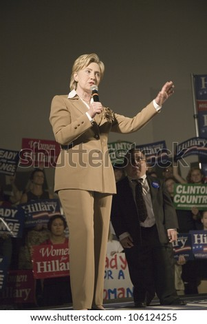 U.S. Senator, Former First Lady and Presidential Candidate, Hillary Clinton next to a midget at rally, following Iowa Democratic Presidential Debate, Drake University, Des Moines, Iowa August 19, 2007