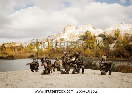 U.S. Soldiers takes a break on a berm during patrol the area