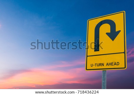 u-turn ahead On the sky background