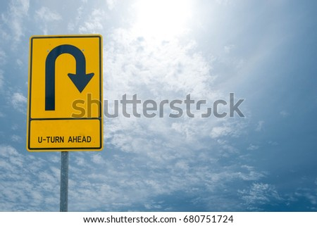 u-turn ahead Split on the sky background