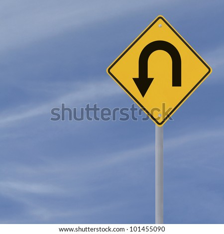 U-Turn road sign on a blue sky background with copy space