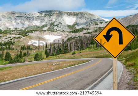 U-Turn Sign:  A sign warns motorists of a sharp bend ahead on a mountain road in southern Wyoming.