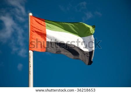 UAE flag against blue sky